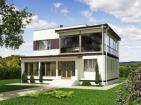 Двухэтажный дом с верандами